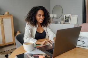 woman-in-white-blazer-using-laptop-computer