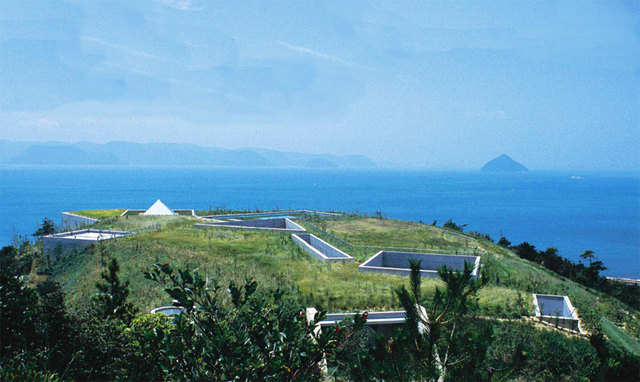 """This """"buried"""" this museum is on Naoshima, Japan's """"art island."""" Small concrete openings and geometrical skylights dot the greenery."""