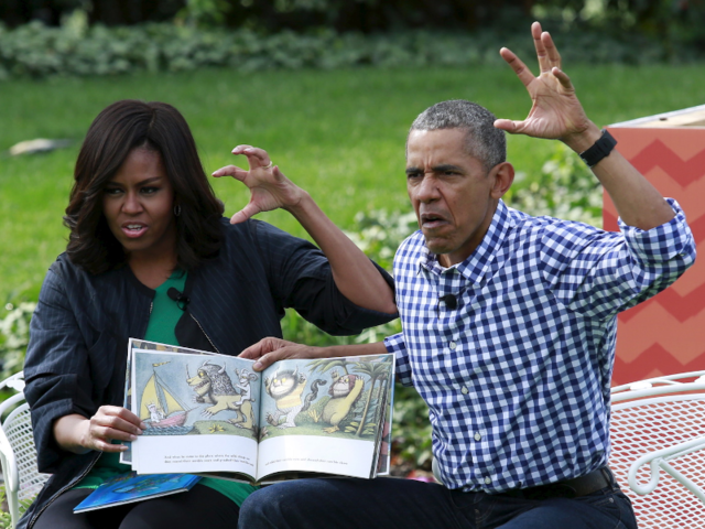 "U.S. President Barack Obama and first lady Michelle Obama perform a reading of the children's book ""Where the Wild Things Are"" for children gathered for the annual White House Easter Egg Roll on the South Lawn of the White House in Washington."