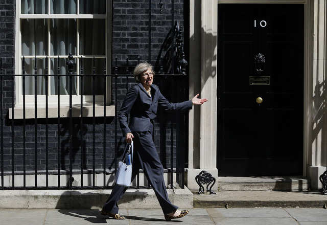 Following David Cameron's final cabinet meeting, then-incoming Prime Minister Theresa May shared a laugh with photographers as she walked the wrong way out of 10 Downing Street.