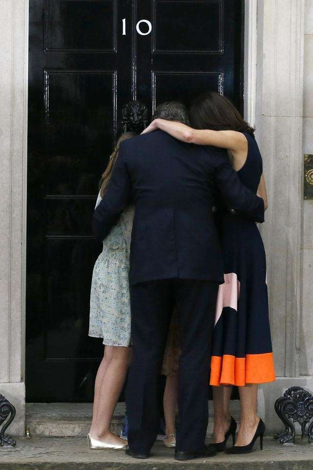Britain's Prime Minister David Cameron, his wife Samantha and their children Nancy, Elwen and Florence, hug on the steps of 10 Downing Street just minutes after Cameron resigned following a shock defeat in the EU referendum.