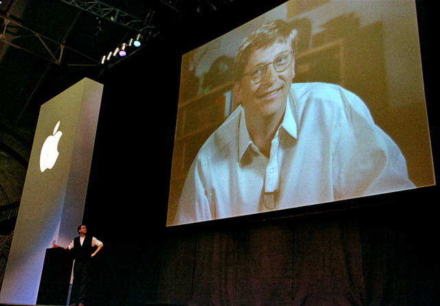 "On July 4, 1997, Jobs persuaded Apple's board to oust Amelio and make Jobs the interim, and then permanent, CEO. In August 1997, Jobs took the stage at another Macworld Expo to announce that Apple had taken a $150 million investment from its long-time rivals at Microsoft. ""We need all the help we can get,"" Jobs said, to boos from the audience."