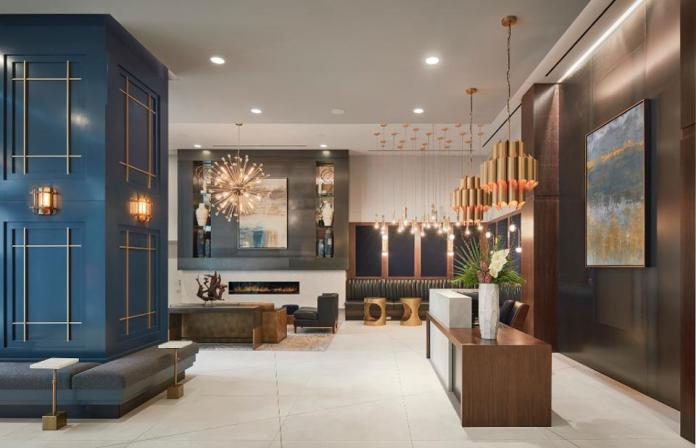 Midcentury modern-designed lobby of The Paragon, a new 500-unit luxury rental build in Chicago.