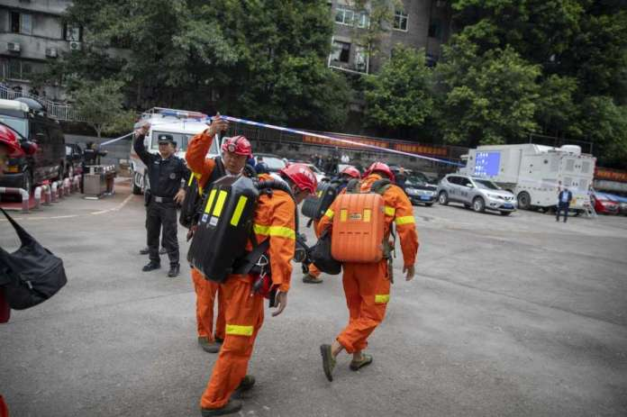 In this photo provided by China's Xinhua News Agency, rescuers arrive at a coal mine in southwest China's Chongqing Municipality, Sunday, Sept. 27, 2020. More than a dozen of people died Sunday in the coal mine in southwestern China because of excessively high levels of carbon monoxide, authorities and state media said. (Huang Wei/Xinhua via AP) Photo: Huang Wei, AP / Xinhua News Agency
