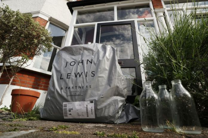 © Reuters. An online delivery package from British retailer John Lewis Partnership is seen on the doorstep of a home in London