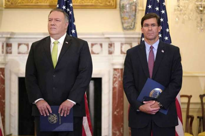 FILE - In this Sept. 21, 2020, file photo Secretary of State Mike Pompeo, left, and Defense Secretary Mark Esper attend a news conference at the U.S. State Department in Washington. Just a week before November's election, Pompeo and Esper will visit India for meetings focused largely on countering China's growing global influence. Photo: Patrick Semansky, AP / Copyright 2020 The Associated Press. All rights reserved.