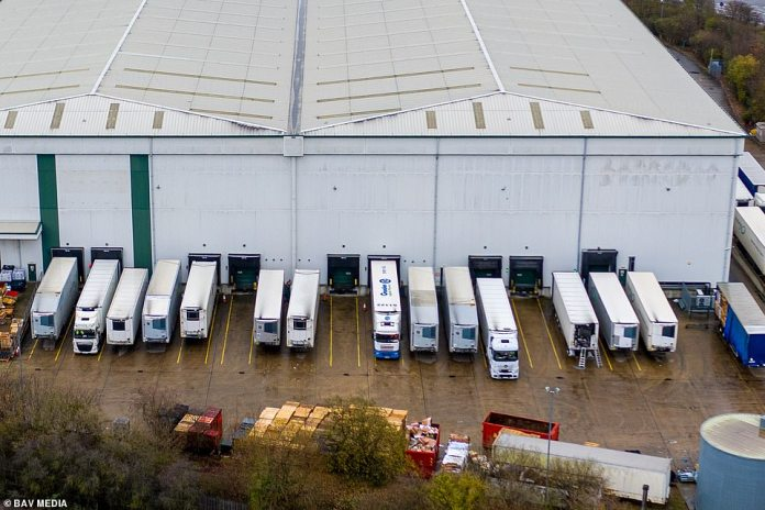 Pfizer's Covid vaccine is reportedly being held in a warehouse in the Midlands. Pictured above, a site in Bedford that had lorries with Belgian number plates arrive this morning