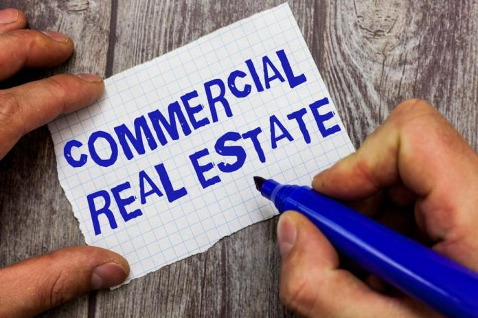 Handwriting text writing Commercial Real Estate. Concept meaning Income Property Building or Land for Business Purpose
