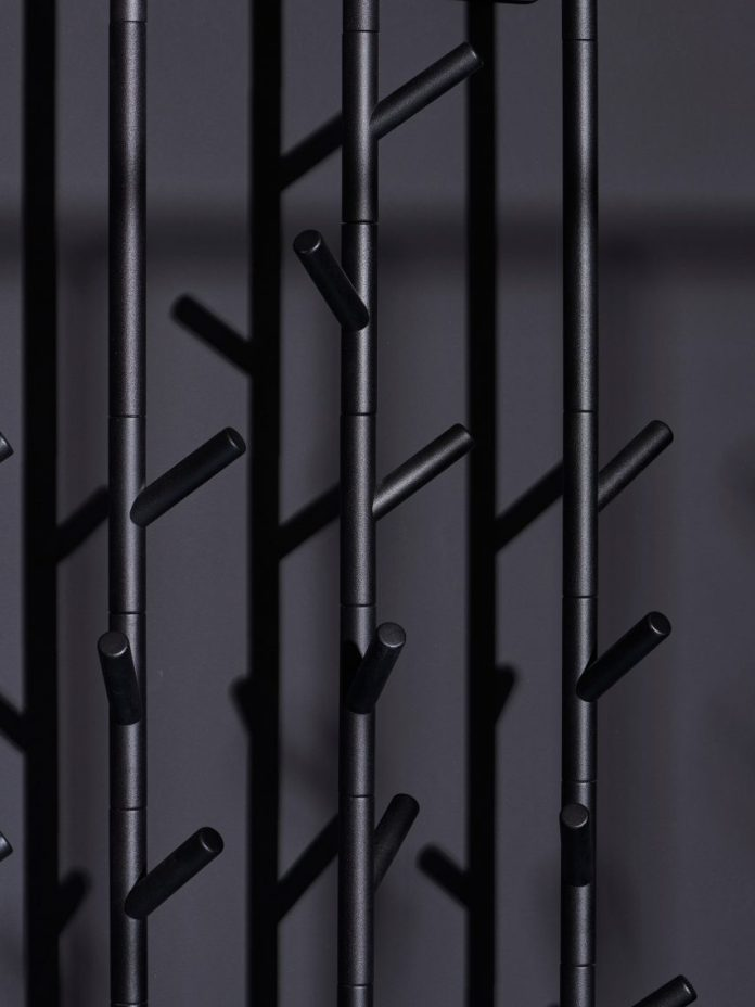 Branch-like hooks on a black coat stand