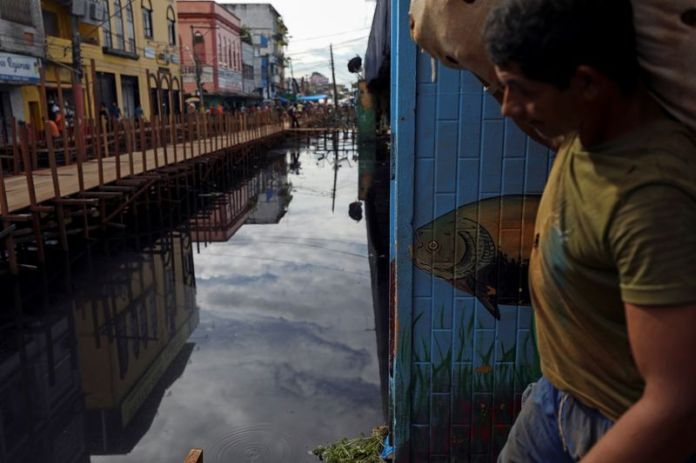 Brazil's pandemic-weary Manaus flooded by rising Amazon rivers