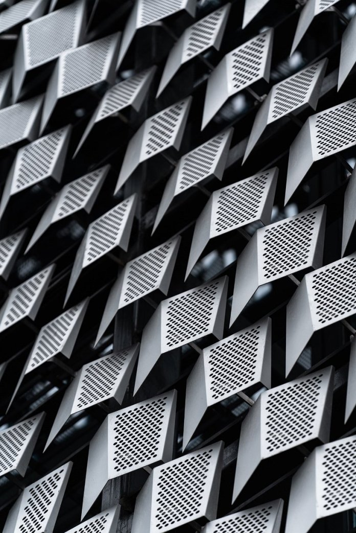 perforated metal screens wrap 10 design's wide horizon clubhouse's façade