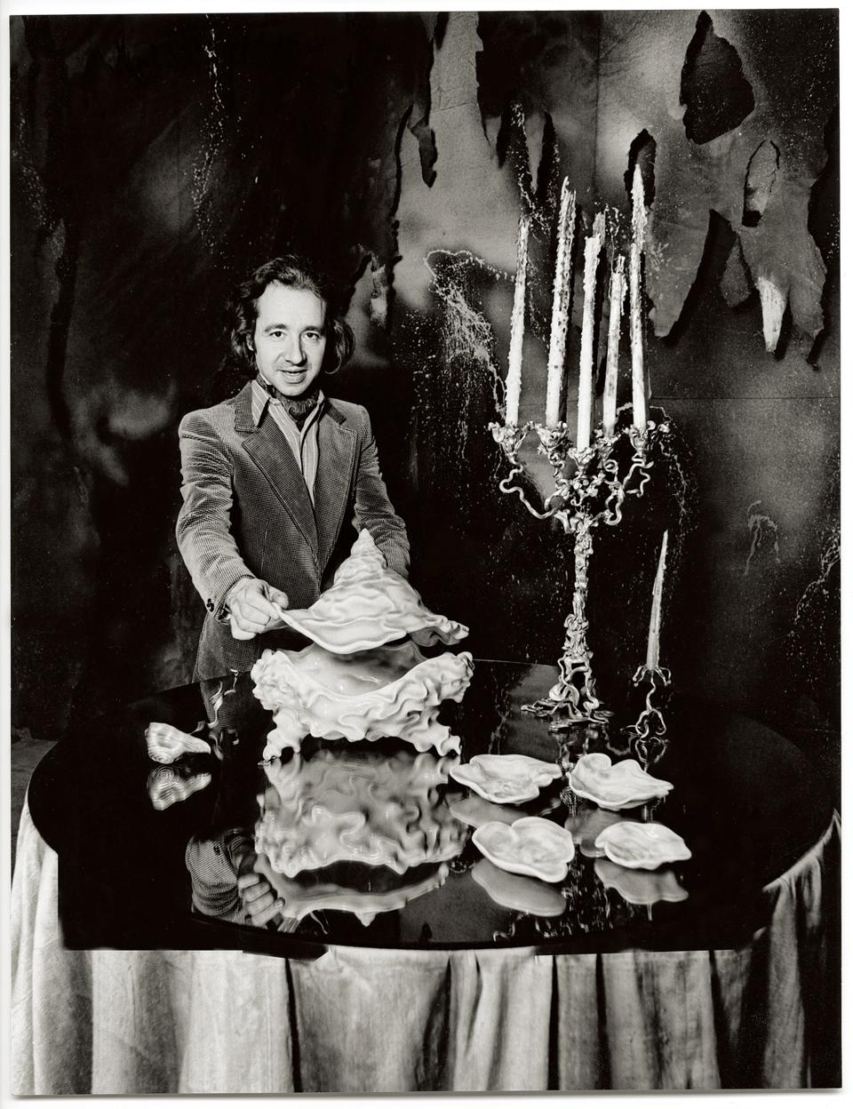 Danish artist Arje Griegst with Royal Copenhagen Triton tureen and bronze candelabra.