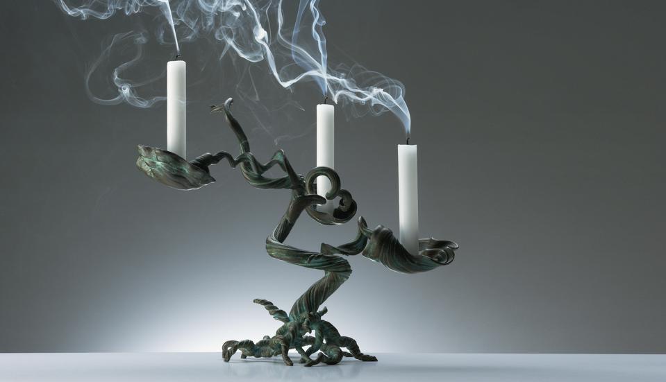 A tree-like bronze candelabra by Arjet Griegst