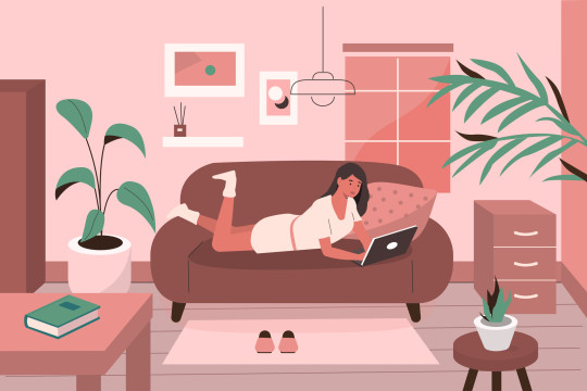 home office - woman working on sofa