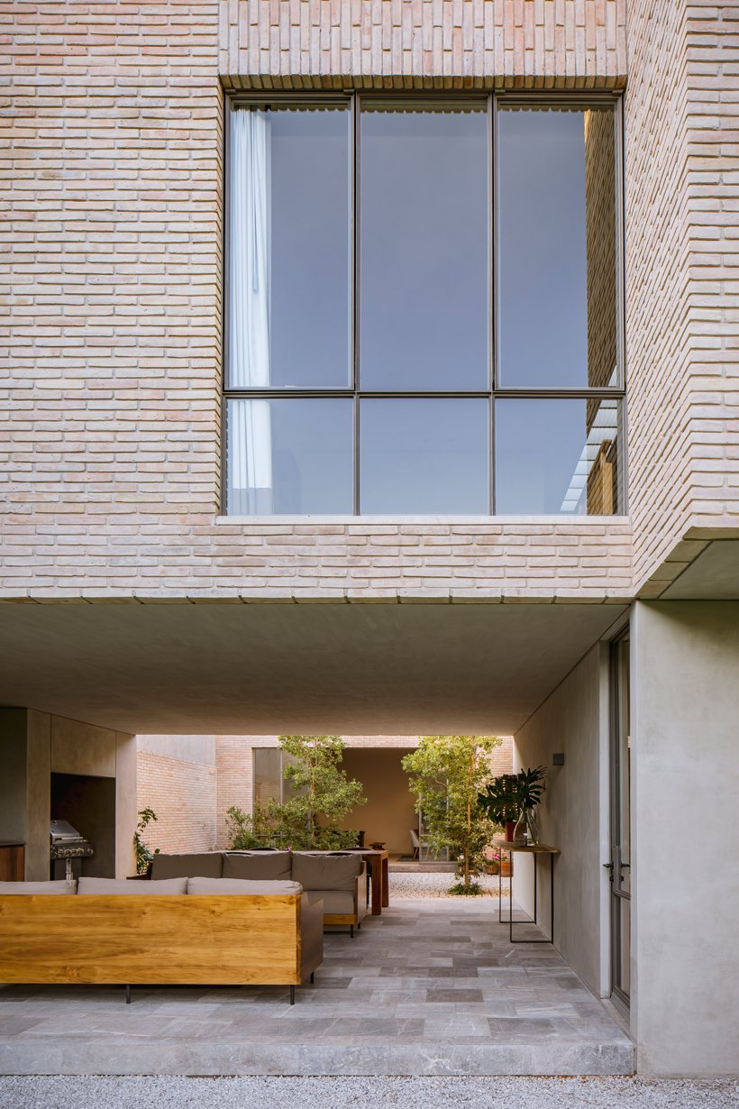 asps white clay brick residence revolves around interior courtyards in mexico city 6