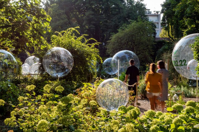 People stroll through the Natural Capital installation at Brera Botanical Garden