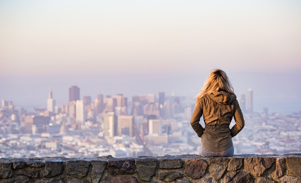 Woman looking at the city in the distance