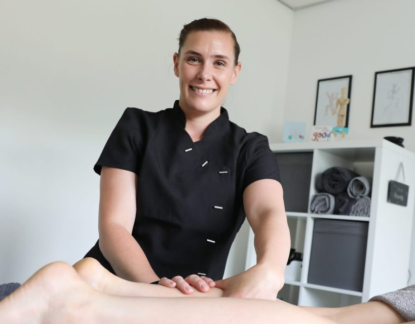 Fitness instructor flexes her muscles as she launches sports therapy business