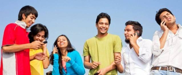 Six Smiling Young Indian Friends People Talking on cell phones and sending SMS and Having Fun