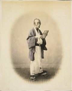 """Mr Shojiro"", holding an abacus"