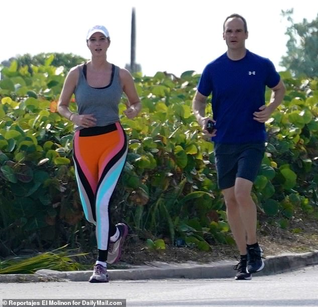Color guard:She was joined by a Secret Service agent (above) as she ran the roads around her family's Palm Beach estate, Mar-a-Lago