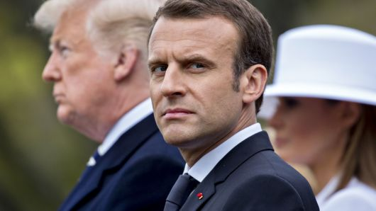 Emmanuel Macron, France's president, center, listens as U.S. President Donald Trump, left, speaks at an arrival ceremony during a state visit on the South Lawn of the White House in Washington, D.C., April 24, 2018.