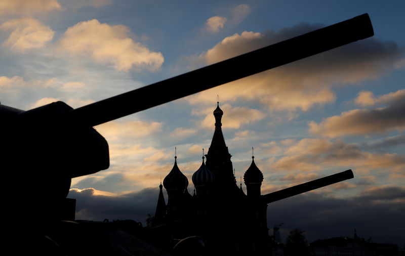 © Reuters. FILE PHOTO: Soviet armoured vehicles are seen in front of the St. Basil's cathedral during a rehearsal for a military parade at the Red Square in Moscow