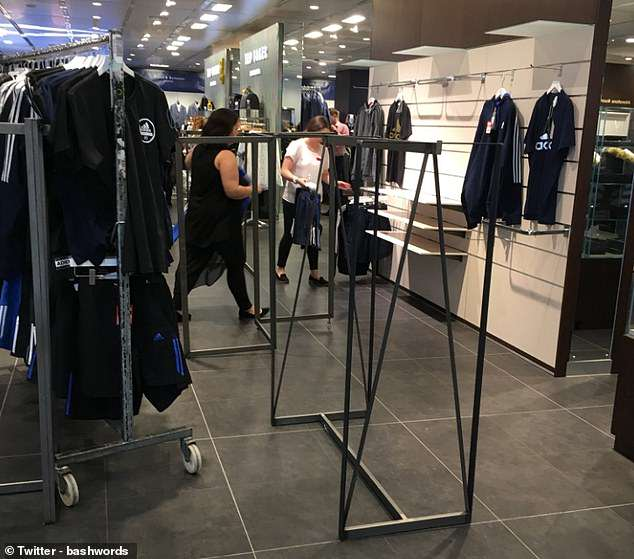 Empty clothing rails in a House of Fraser branch. Sports Direct boss Mike Ashley promised to turn the store into 'the Harrods of the high street' when he bought the chain for £90m