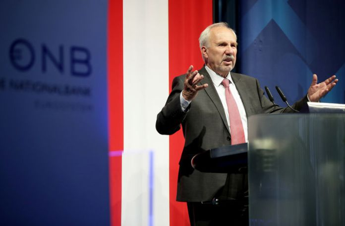 © Reuters. FILE PHOTO: Austria's National Bank, OeNB, Governor Ewald Nowotny speaks during an economics conference in Linz