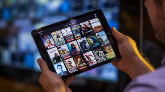 A selection of Netflix original content sits displayed in the Netflix app on an Apple iPad tablet device in this arranged photograph in London.