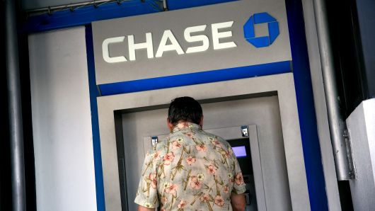 A customer uses a JPMorgan Chase & Co. automatic teller machine (ATM) outside a bank branch in Miami, Florida, U.S., on Thursday, Jan. 5, 2017. J