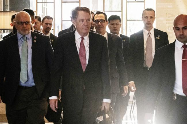 © Bloomberg. Robert Lighthizer, U.S. trade representative, center front, and Steven Mnuchin, U.S. Treasury secretary, center rear, arrive at a hotel in Beijing, China, on Thursday, March 28, 2019. Lighthizer and Mnuchin are in Beijing for high-level talks beginning Thursday, while top Chinese negotiator Vice Premier Liu He plans to travel to the U.S. the following week. Photographer: Gilles Sabrie/Bloomberg
