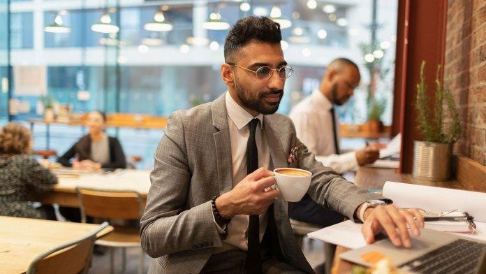 Man using laptop in coffeeshop