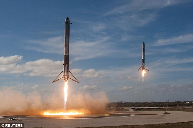 The solid rocket boosters of SpaceX's first Falcon Heavy rocket landing at the Kennedy Space Center in Florida