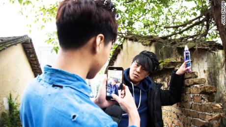 Wu Nengji shoots a scene for his video. He uses one smartphone and never does more than two takes.