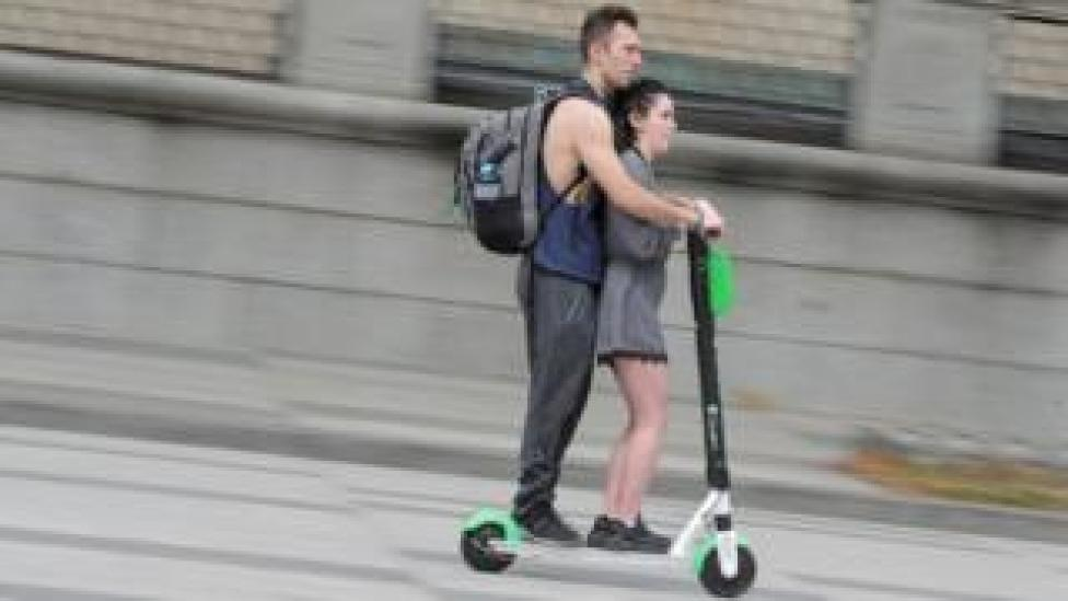 Riders on Lime e-scooter