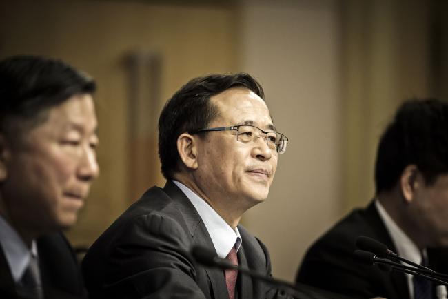 """© Bloomberg. Liu Shiyu, chairman of the China Securities Regulatory Commission (CSRC), looks on during a news conference on the sidelines of the fourth session of the 12th National People's Congress (NPC) in Beijing, China, on Saturday, March 12, 2016. China's new stock regulator vowed to step in """"decisively"""" if needed to stem the sort of stock-market panic that resulted in a $5 trillion wipeout last summer, adding that it was far too early to think about the state rescue fund leaving the market. Photographer: Qilai Shen/Bloomberg *** Local Caption *** Liu Shiyu"""