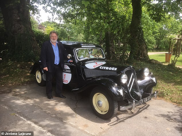 Citroen is celebrating its centenary year Paris where 100 of the firm's most historic cars were on display near the Eiffel Tower. Daily Mail's Ray Massey pictured with one of the vintage models