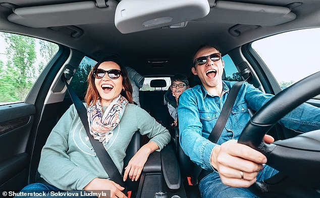 It might embarrass the kids, but singing along to the car radio can, temporarily, make you happy (stock image)