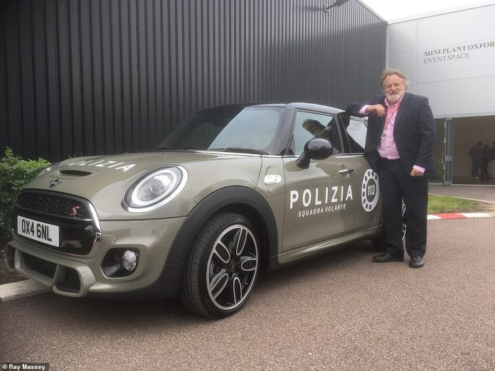 Our man Ray Massey pictured with the modern-era Mini painted in Polizia colours that featured in the video