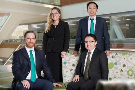 Four surgeons in business attire in the Jacobs School of Medicine and Biomedical Sciences at UB.
