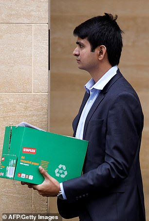 Cull: One of the 18,000 Deutsche staff to lose their jobs leaves the bank's London office with his possessions in a box