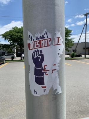 The remnants of a white supremacist propaganda sticker posted in the Market Basket parking lot in Leominster.