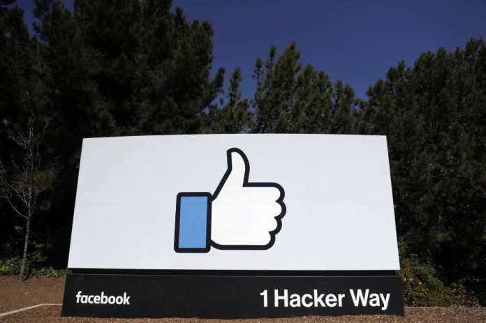 FILE - This March 28, 2018, file photo shows a Facebook logo at the company's headquarters in Menlo Park, Calif. Facebook's ambitious plan to create a new financial system based on a digital currency faces questions from lawmakers, as it's shadowed by negative comments from President Donald Trump, his Treasury secretary and the head of the Federal Reserve. Photo: Marcio Jose Sanchez, AP / Copyright 2018 The Associated Press. All rights reserved.