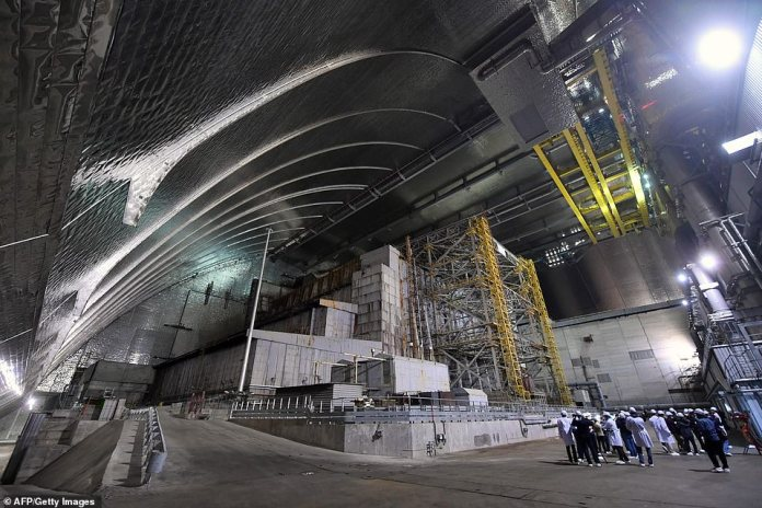 A £2 billion ($2.4bn) replacement to the original sarcophagus, which took nine years to build, was unveiled in July. Pictured: An interior view of the New Safe Confinement metal dome that now shields the world from any radiation left within the site of the disaster