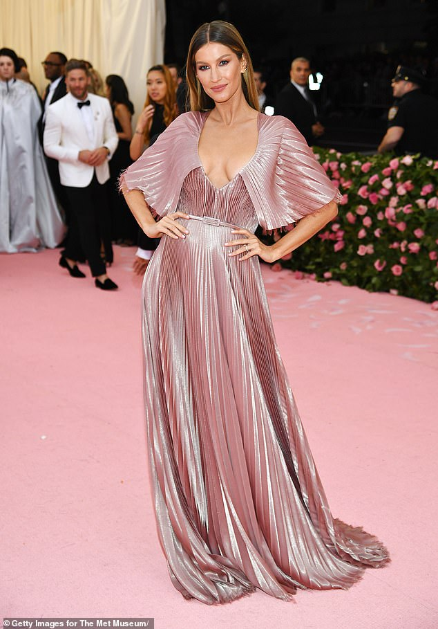 Gisele Bündchen is among the host of celebrities who shunned a hospital birth, saying her home was 'where she felt safe'. The model is pictured at theThe 2019 Met Gala in New York