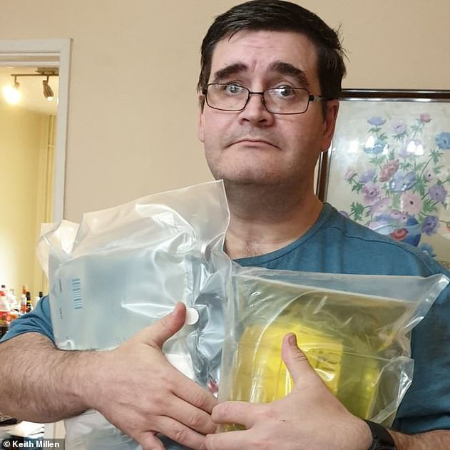 Keith Millen, 48, whose supply also stopped, said he was 'petrified' for his life. He is pictured holding a supply of intravenous nutrition at his home inBridgend