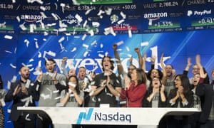 Adam Neumann, center, attends the opening bell ceremony at Nasdaq in New York, on 16 January 2018.