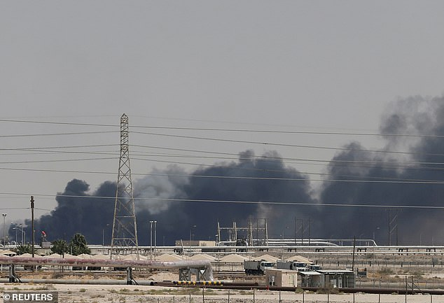 Smoke rises following a drone strike on the Aramco facility in Abqaiq, Saudi Arabia.When markets reopened the price of oil rose almost 20 per cent to just under $72 a barrel