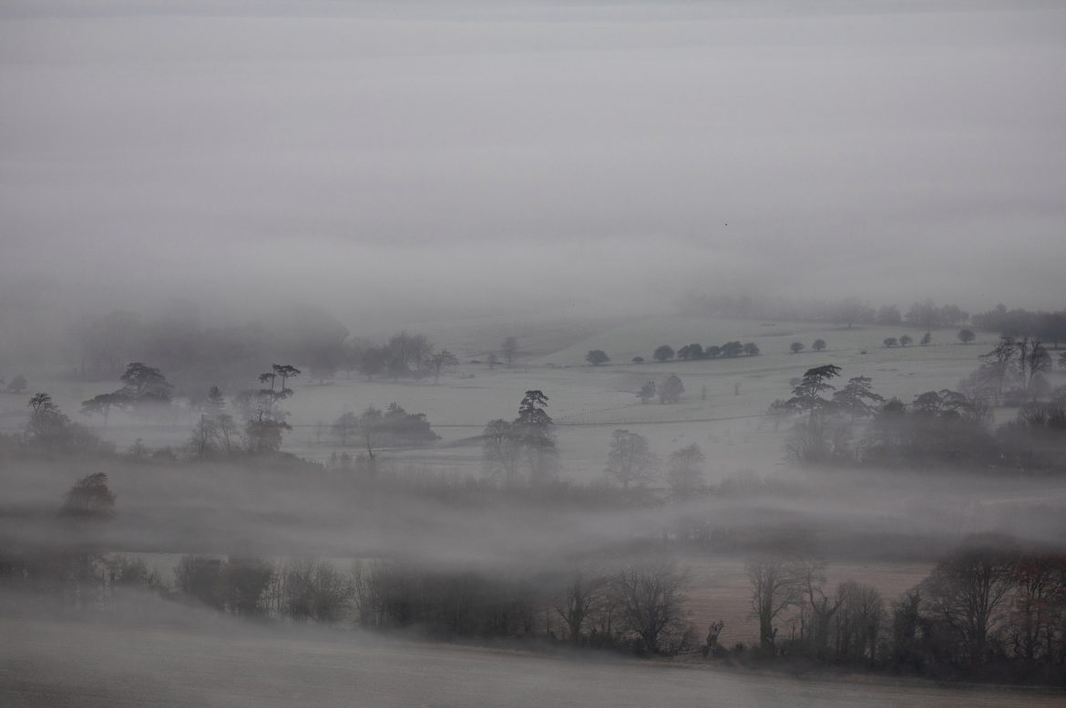 Mist lingers in the valley below Firle Beacon in the South Downs this morning as temperatures plummeted